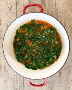 Adding the tomato paste mixture to the spanakorizo